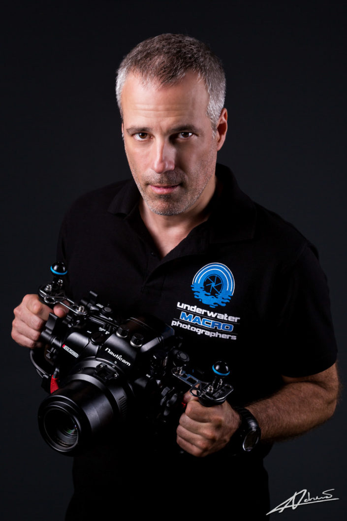 Corporate portrait headshot of man with camera.