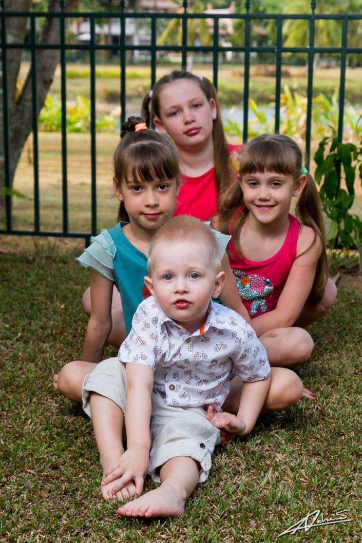 Family portrait children on the grass.