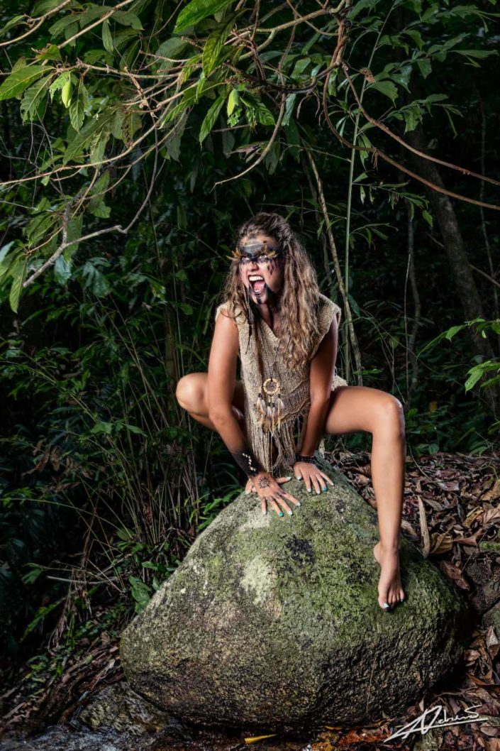 Fantasy photography wild woman on the rock.