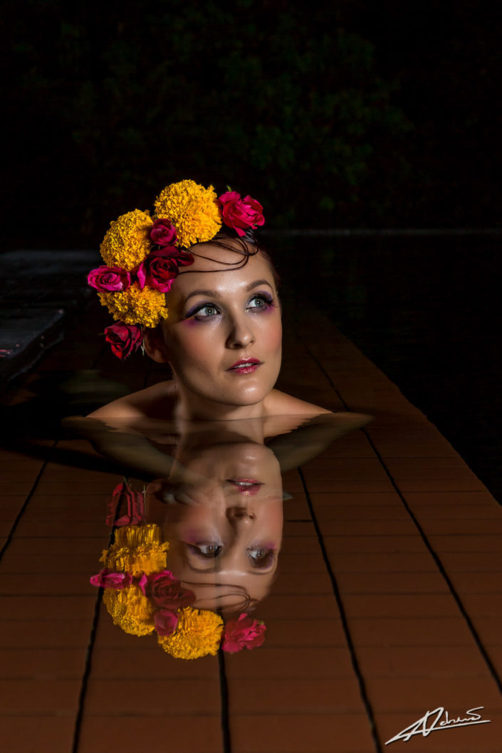 Fantasy photography woman in the pool with reflection.