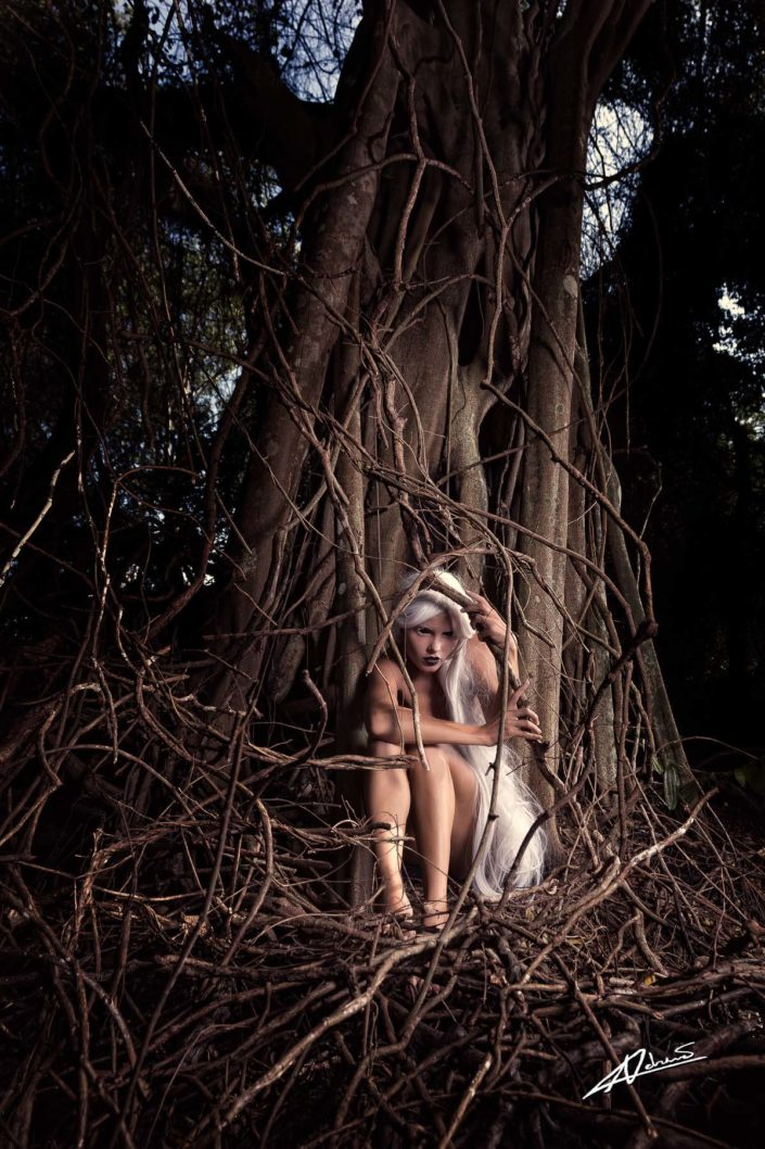 Fantasy photography woman in tree roots.