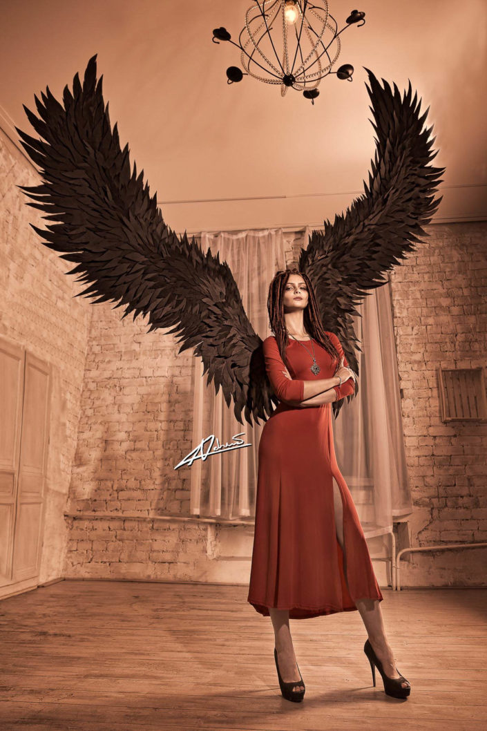 Fantasy photography woman with black wings.