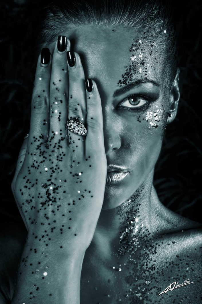 Fantasy photography woman with silver face bodypaint.