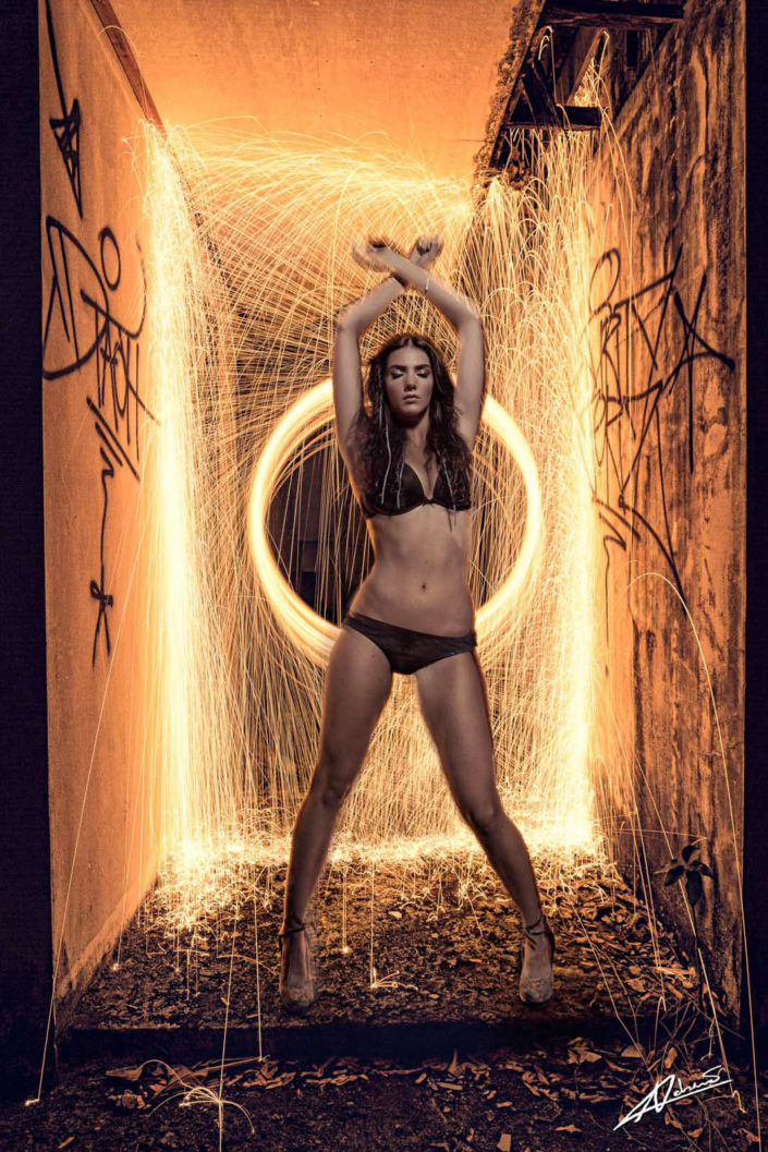 Fantasy photography woman with steel wool background.
