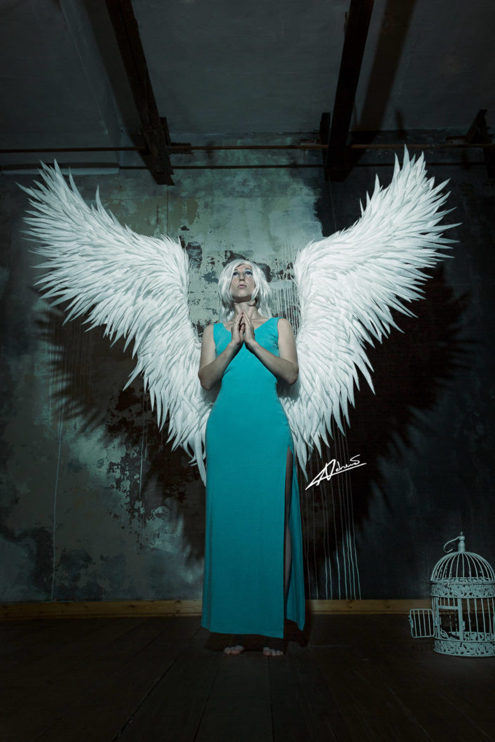 Fantasy photography woman with white wings.
