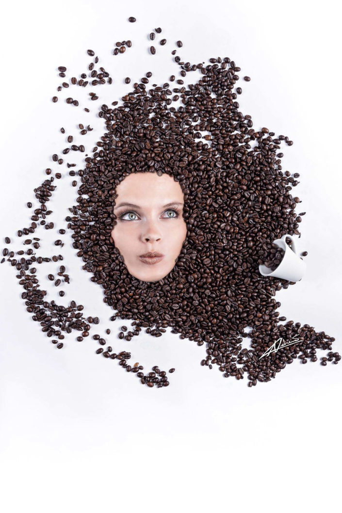 Fantasy photography woman's face in coffee beans