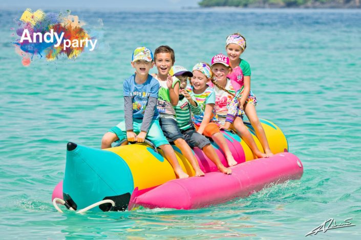 Fashion photography Andy party clothes children on the banana boat.