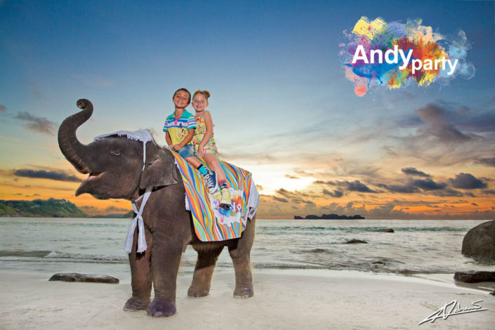Fashion photography Andy party clothes children ridning elephant.