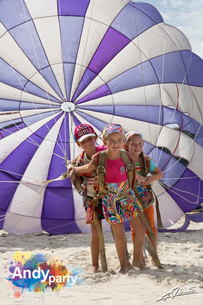 Fashion photography Andy party clothes children with parachute.