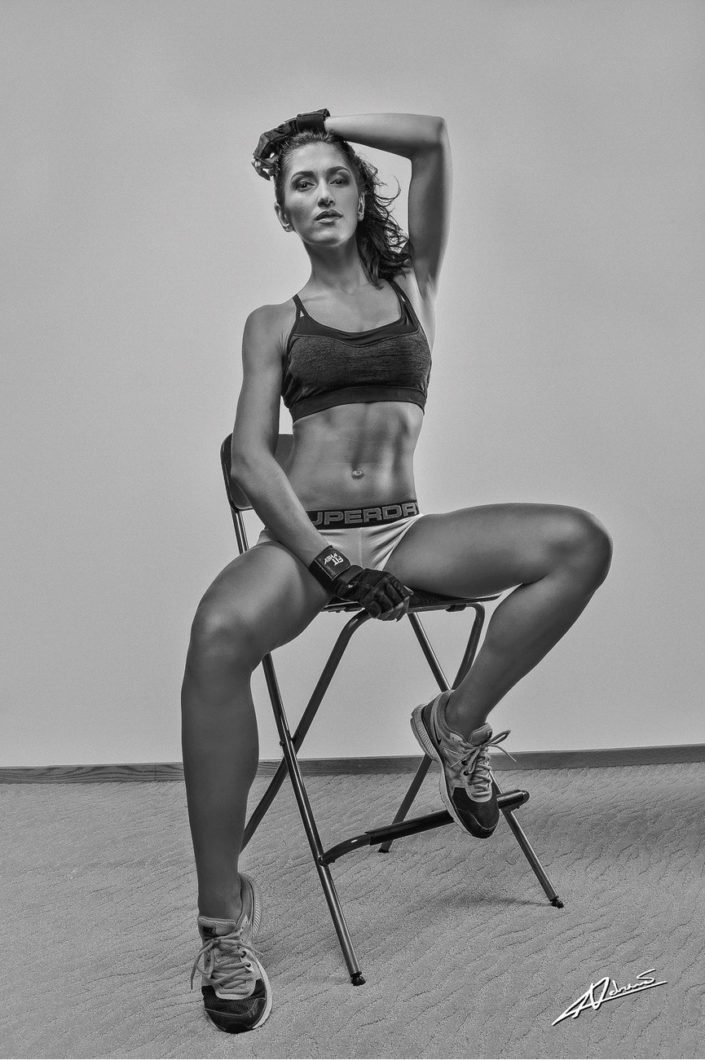 Fitness photography fit woman on a chair.