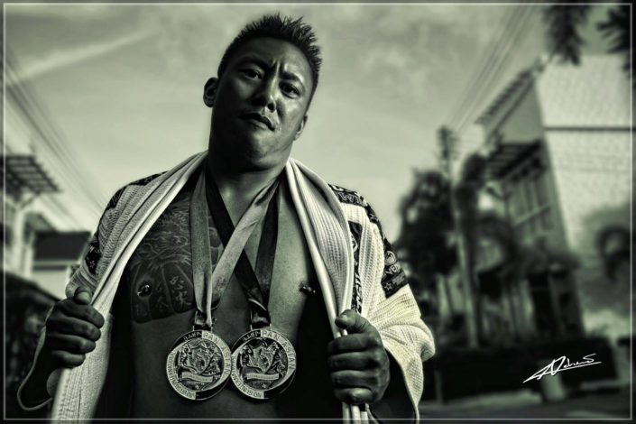 Fitness photography man with bjj medals.
