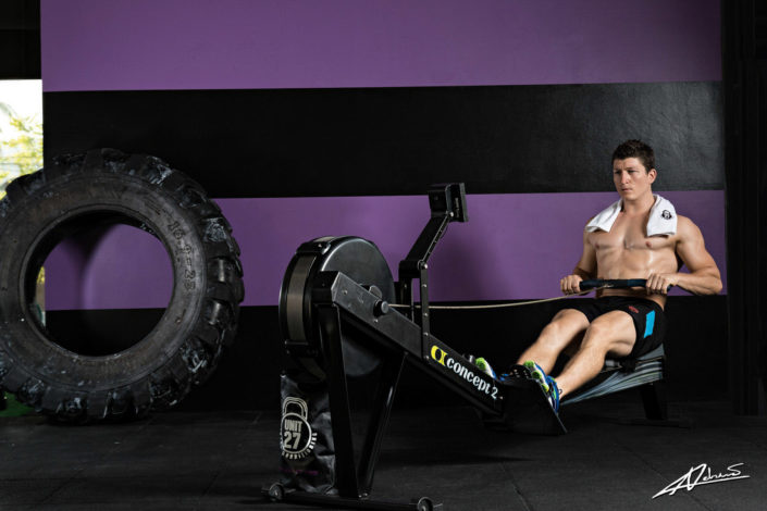 Fitness photography man with rowing machine.