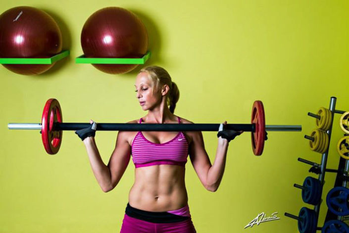 Fitness photography trainer with weights.