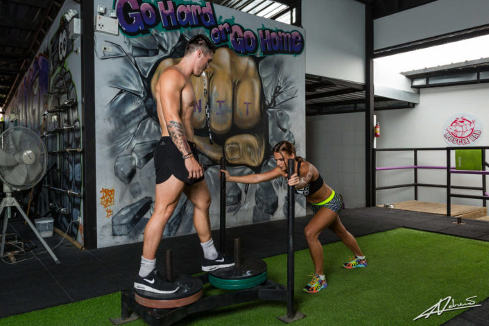 Fitness photography woman and man training.