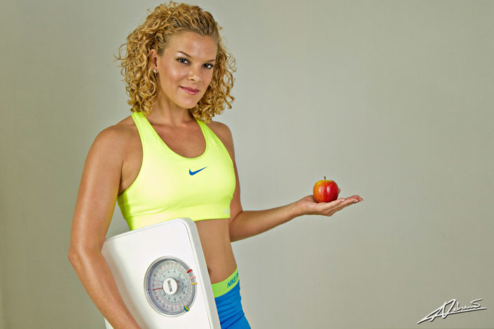 Fitness photography woman with a scale in the studio.