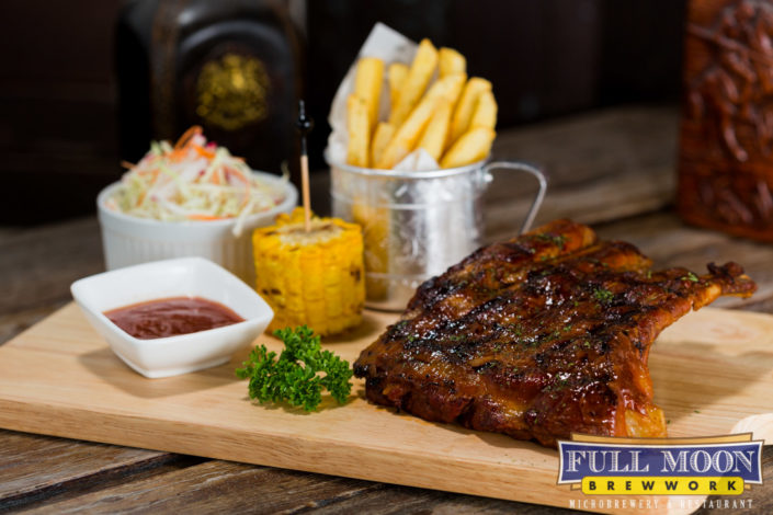 Food and drinks Full Moon brewwork BBQ baby back ribs.