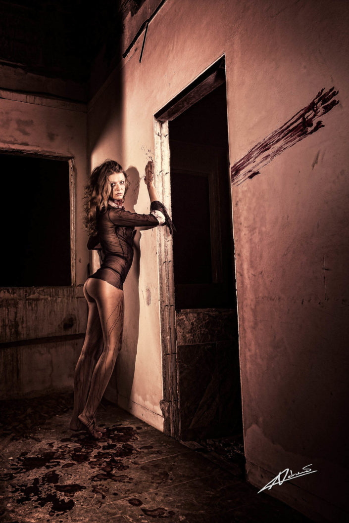 Nude photography woman in the abandoned house as bloody mary style.