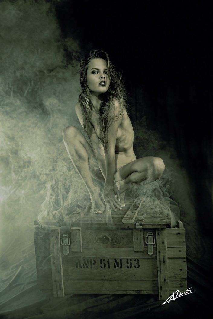 Nude photography woman on a smoking box.
