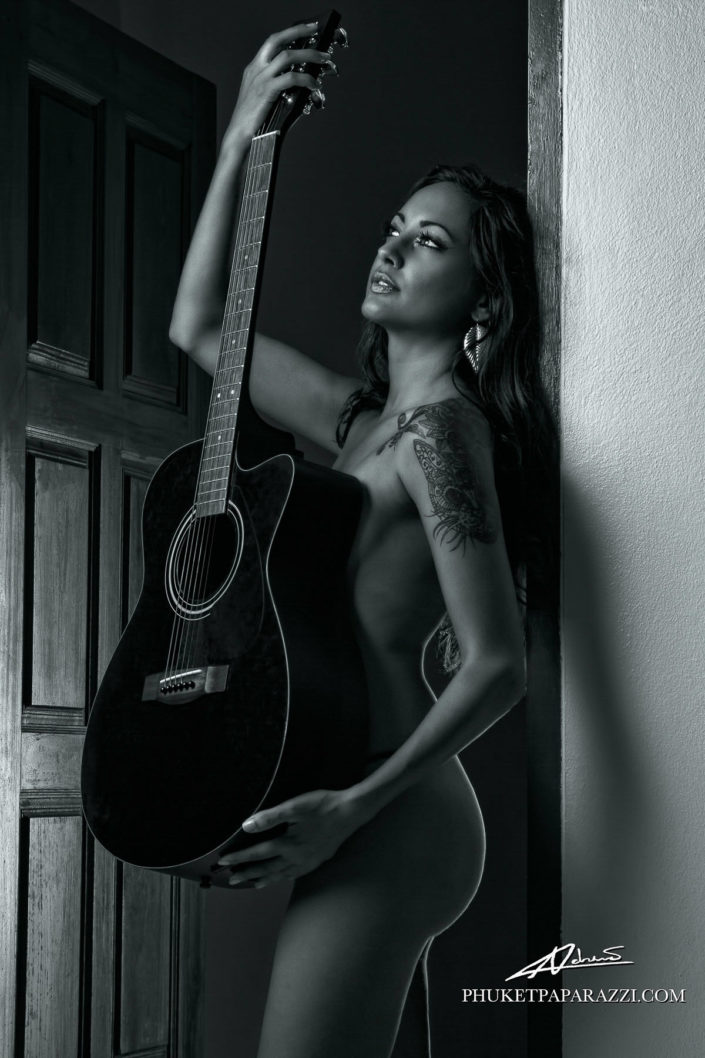 Nude photography woman with guitar.