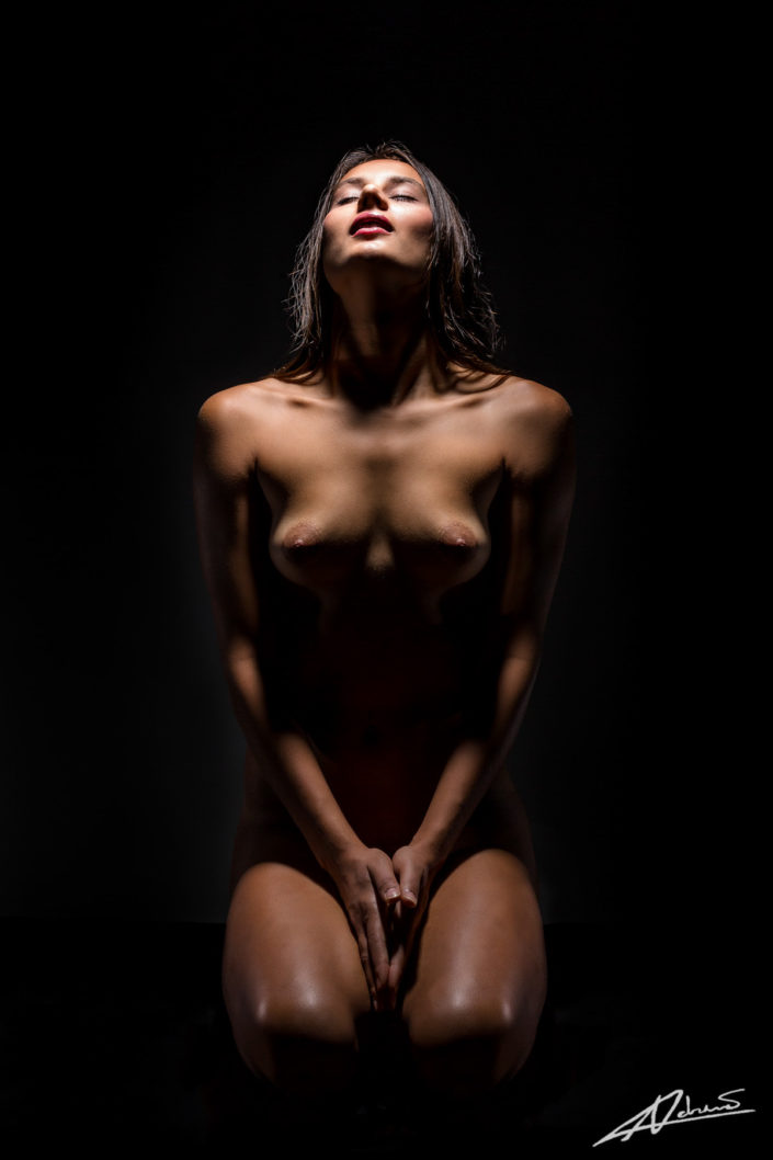 Nude photography woman with shadow in the studio.