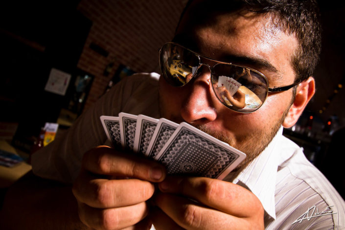 Portrait photography man with cards.