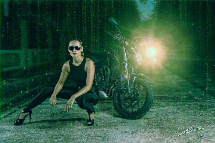 Portrait photography woman as martix style with motorcycle.