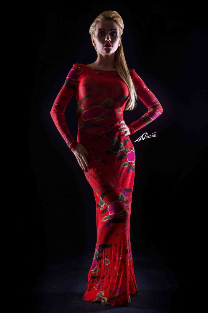 Portrait photography woman posing with red dress in the studio.
