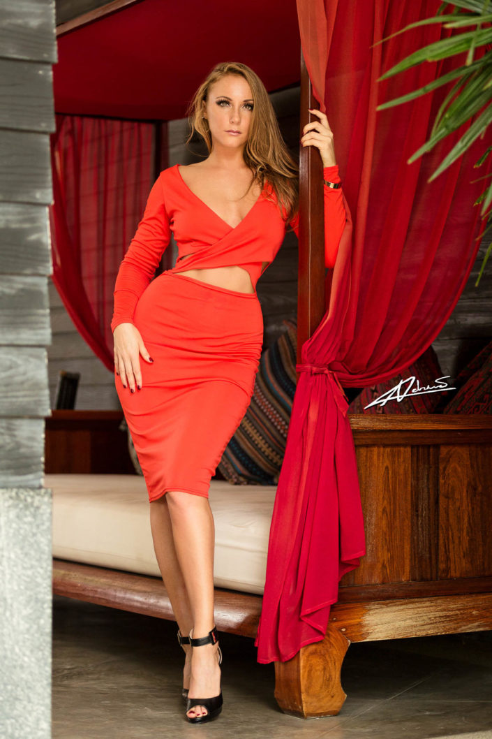 Portrait photography woman posing with red dress.