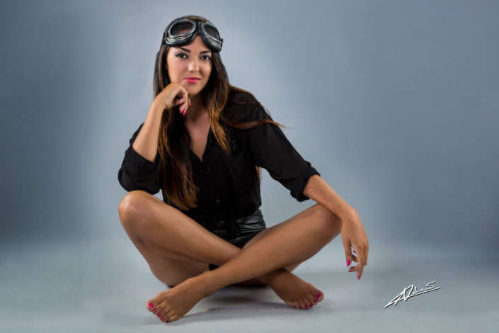 Portrait photography woman with pilot goggles.