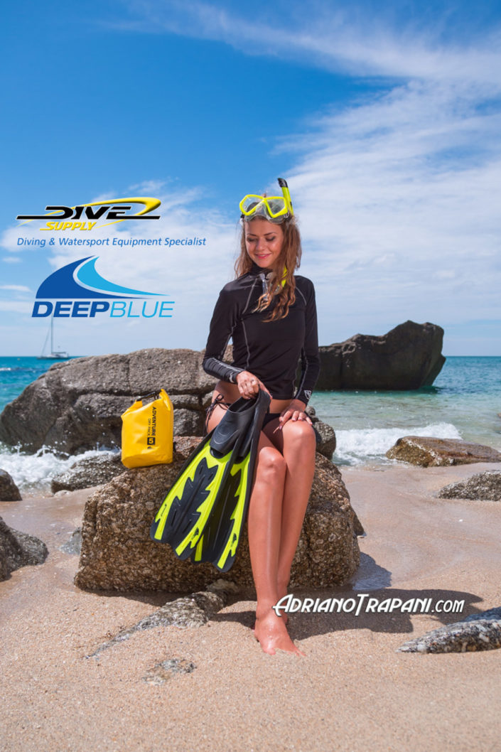 Product photography Dive Supply Deep Blue female equipment for snorkeling and rashguard.