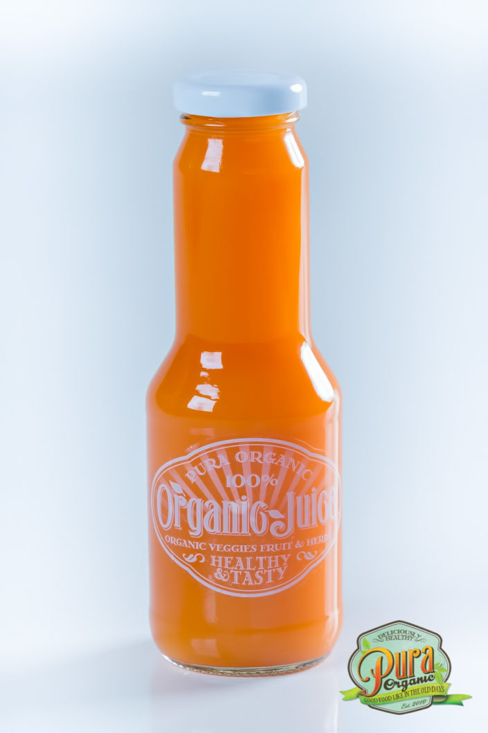 Product photography Pura organic juice bottle.