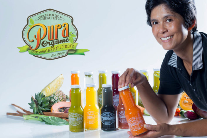 Product photography Pura organic juice bottles with woman.
