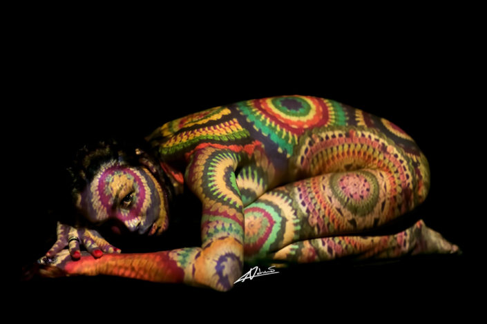 Projections-nude photography woman lying with a multi-colored circles picture.