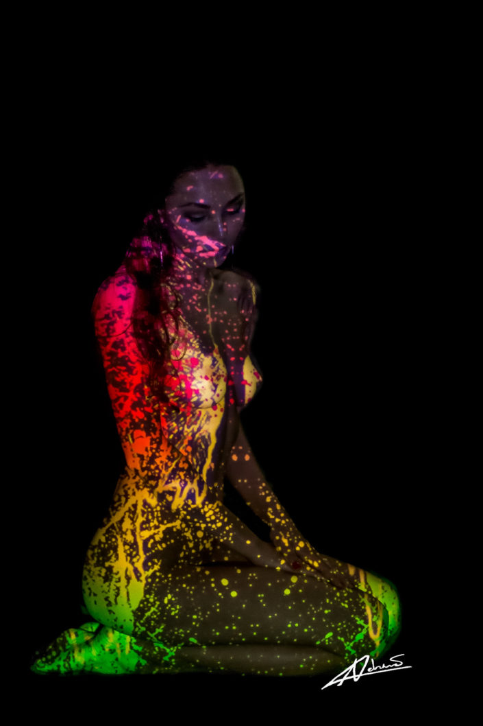 Projections-nude photography woman sitting side with colorfull drops picture.