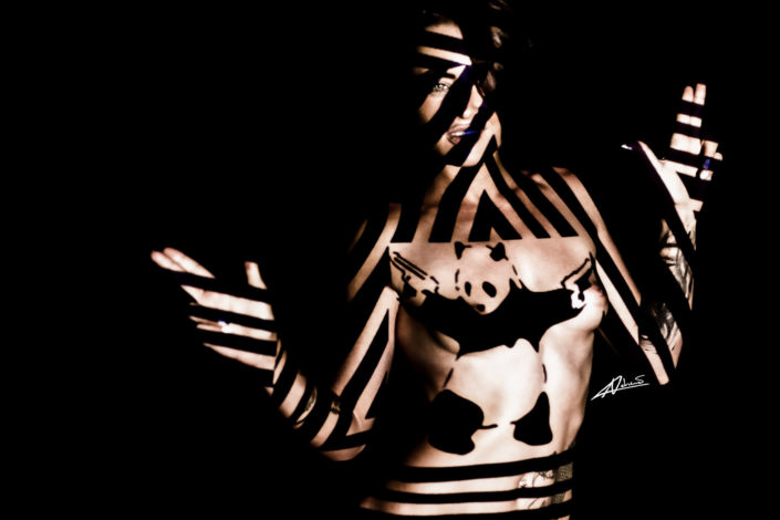 Projections-nude photography woman with I am banksy panda with guns picture.