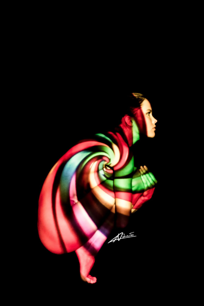 Projections-nude photography woman with colorfull picture.