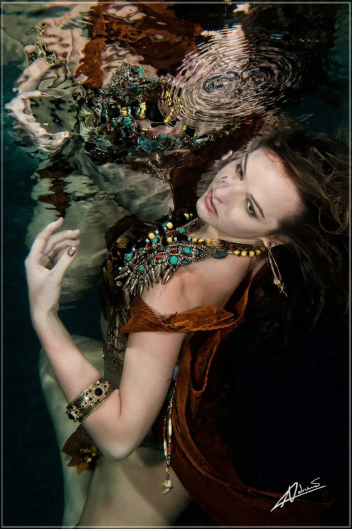 Underwater portrait woman with accessories.
