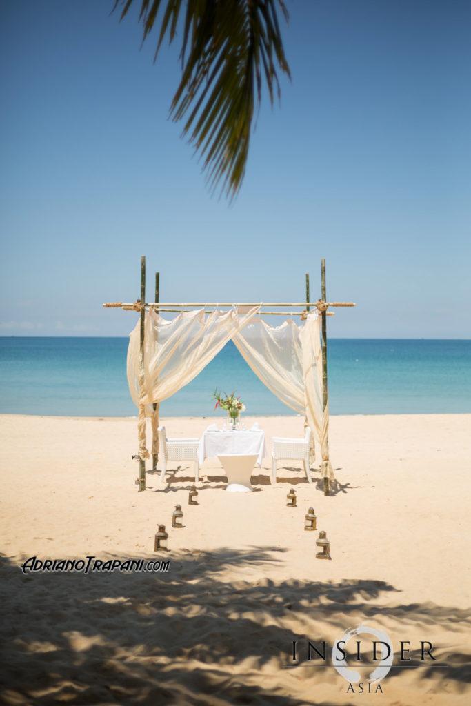 Akyran beach club table on the beach for romantic dinner.