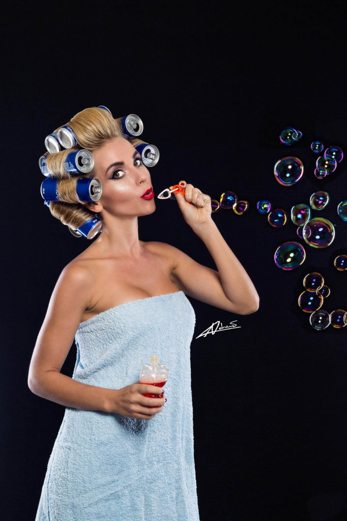 Fantasy photography woman blowing soap bubbles.