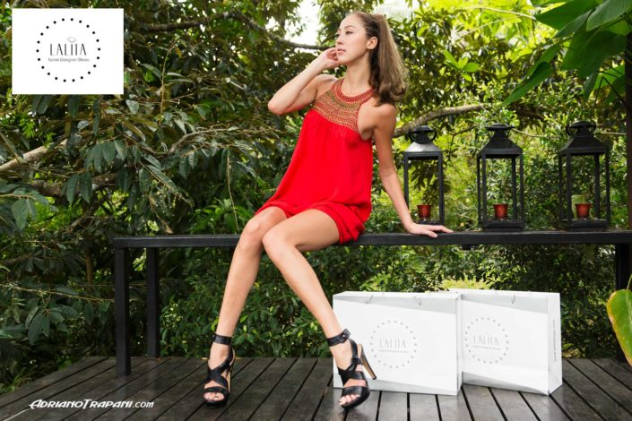 Fashion photography Lalita shoes model sitting on the bench.