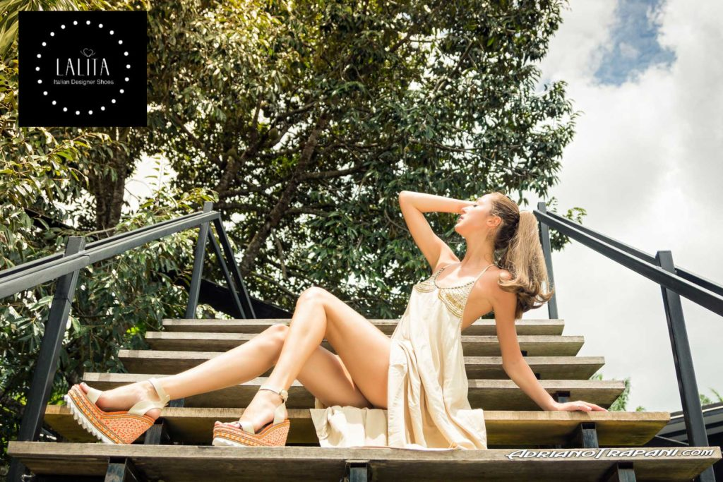Fashion photography Lalita shoes model sitting on the stairs.