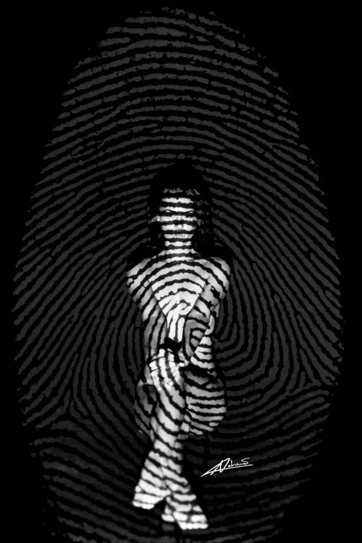 Projections woman sitting with fingerprint picture.