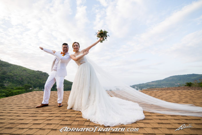 Wedding photography bride and groom funny pose on roof top.