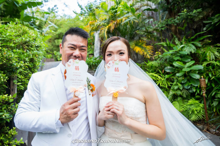 Wedding photography bride and groom with paper-fan invitation cards.