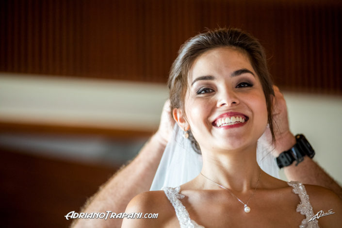 Wedding photography bride smiling while getting ready.