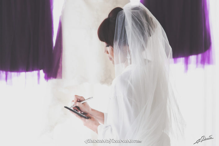 Wedding photography bride writing vows.