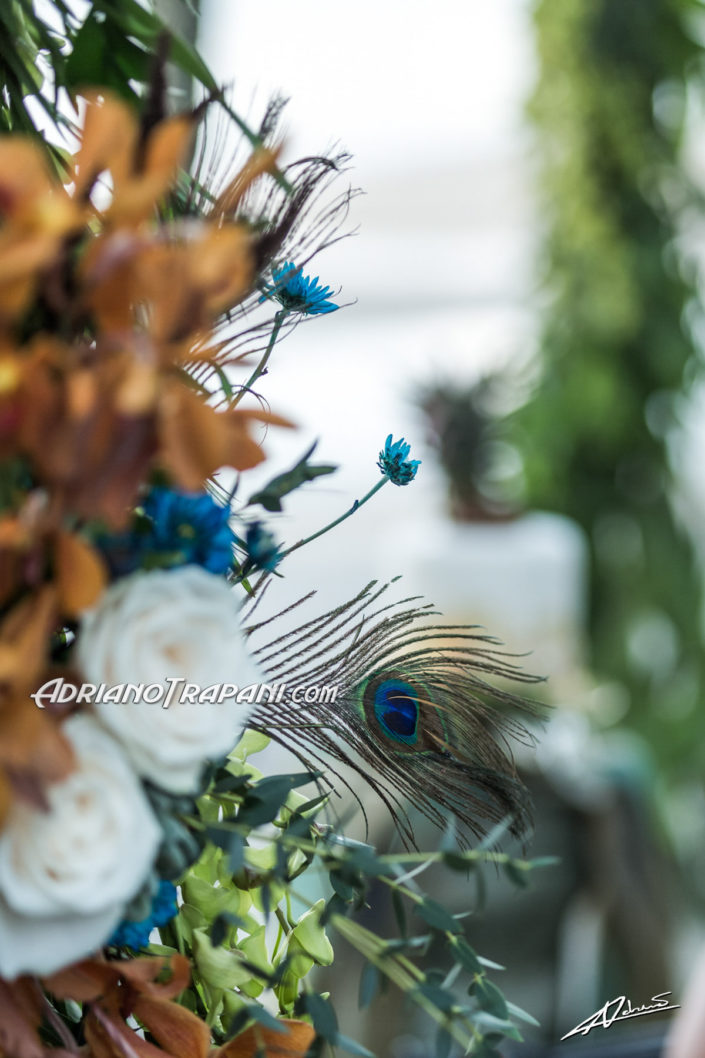 Wedding photography detail of peacock and copper themed wedding.